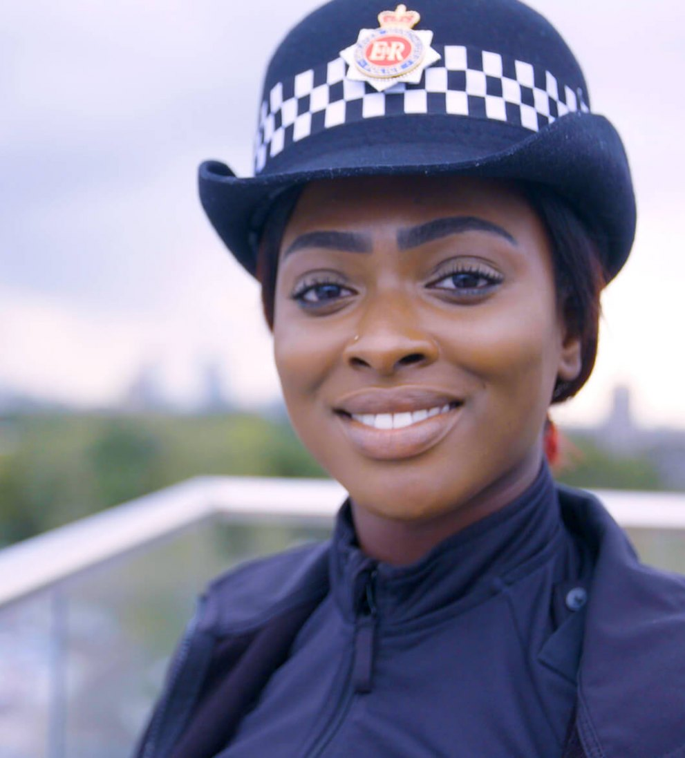 Image of female police officer smiling.